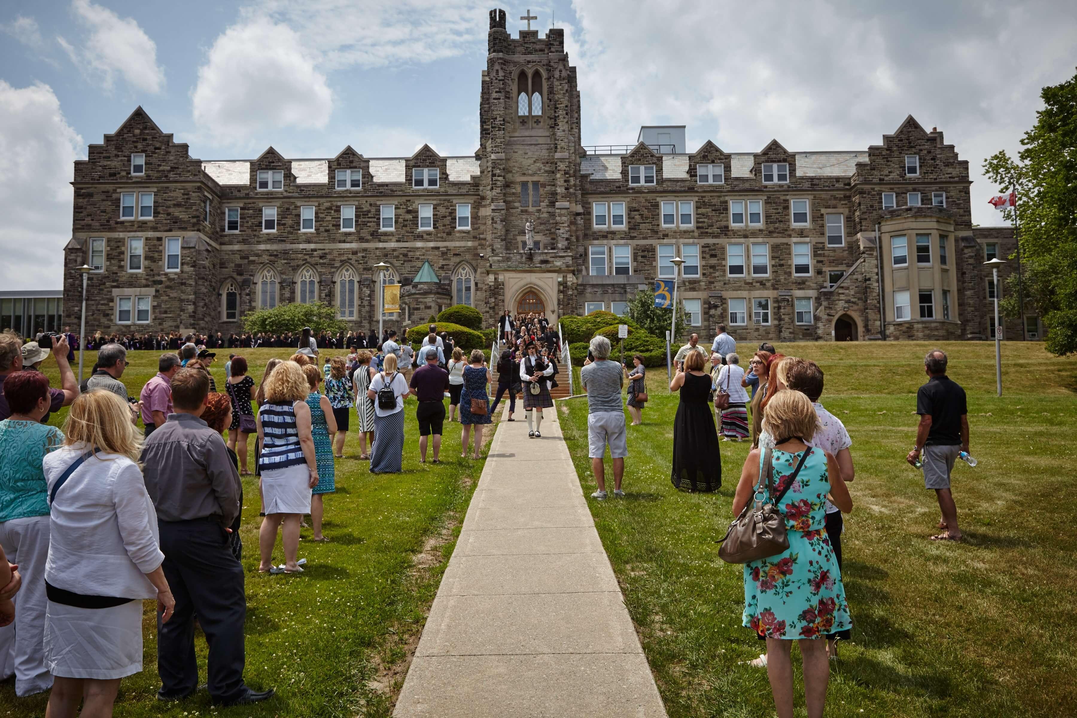 crowd in front of brescia university college building
