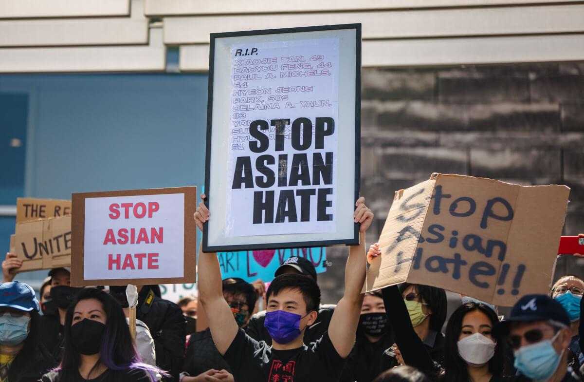 protestors demanding stop asian hate